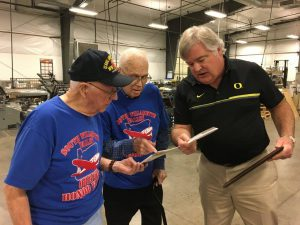 Photo In Our Community - Doug Koke showing off print samples to visiting veterans.